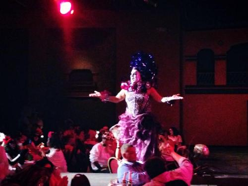 "Singing Whitney Houston's ""I Will Always Love You."" This was at a Dia de los Muertos drag and fashion show at the Guadalupe Cultural Arts  Center in San Antonio, which raised money for local food pantries and college scholarships."